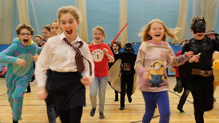 Year 7 Cadbury House at Roundwood Park School dress up as childrens TV and film characters to raise