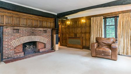 Wood panelling and a classic hearth in the living room at Lane End