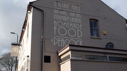 The corrected sign on the side of the newly decorated Peacock pub
