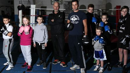 Dave Blows and Billy Crotty, pictured centre, with members of Royston Amateur Boxing Club