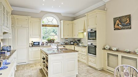 The home boasts a stunning, spacious and airy kitchen