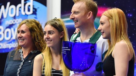 Nicky Brett celebrates his world title success with his wife, Sam, and daughters, Chloe and Lauren.