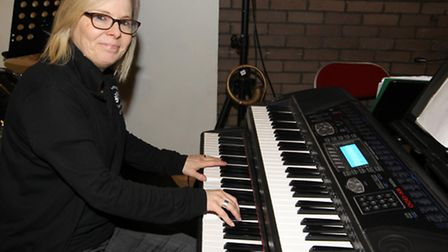 Louise Atkins, Musical Director, plays the piano