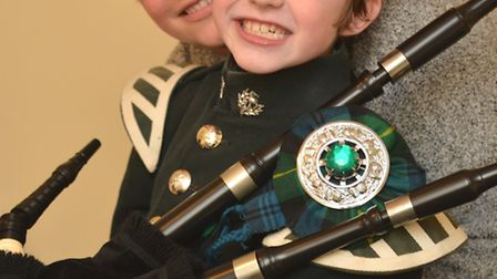 Bagpipe player Vincent Forkner, from Ramsey St Marys, with mum Victoria Askey.