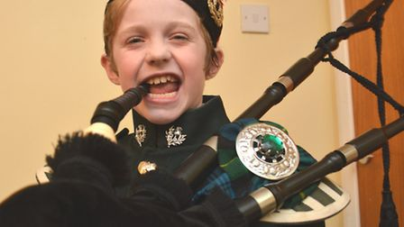 Bagpipe player Vincent Forkner, from Ramsey St Marys,
