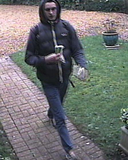 Police release CCTV images of two men they would like to speak to in connection with a burglary in A