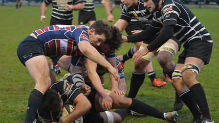 OAs look to steal the ball at a ruck against Chinnor. Picture: KEVIN LINES