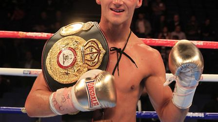 Tommy Martin celebrates winning the WBA Continental title in September. Picture: LAWRENCE LUSTIG