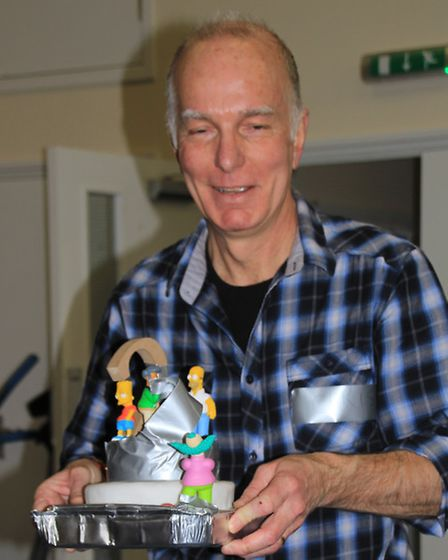 Chris Lee presents the cake at the second anniversary celebrations. PICTURE: Clive Porter.