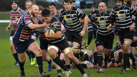 Player-coach James Shanahan attempts to stop a Chinnor attack. Picture: KEVIN LINES