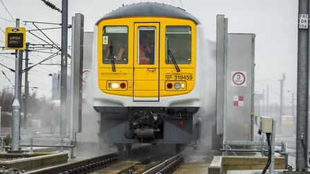 A Thameslink service goes through the newly-installed train washing facilities at Cricklewood siding