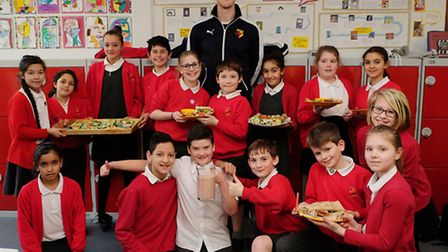 Watford goalkeeper Rene Gilmartin with the year 6 class at Margaret Wix Primary School to promote he