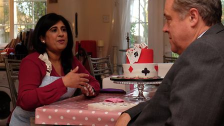 Local business owner Sajida Kamraan speaks to MEP Richard Howitt about her struggles in setting up h