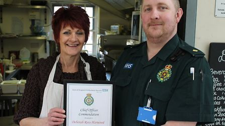 Debbie Ross- Harwood with her chief officer commedation presented by paramedic Russ Rookley