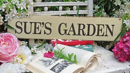 The personalised wooden garden sign, available from ijustloveit.co.uk (PA Photo/Handout)
