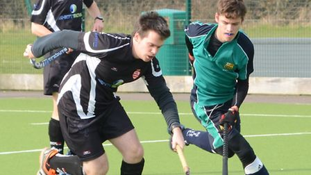 Will Jones (right) of St Ives Men's 3rds during their defeat last Saturday.
