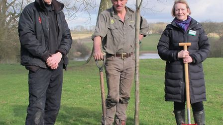 Dame Helen Ghosh planting a tree in the North Park at Wimpole pictured with Ashley Baker Volunteer R