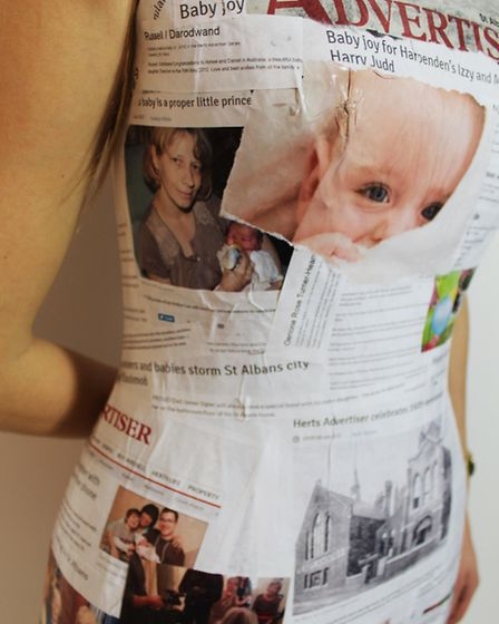 Lucy focused the dress around the births, marriages and deaths section of the paper