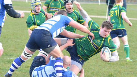 Rory Parker in the thick of the action for Huntingdon. Picture: HELEN DRAKE