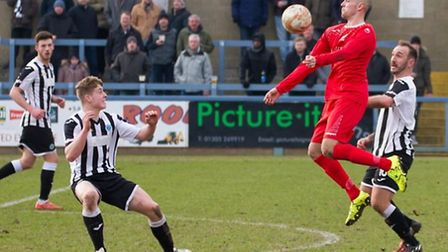 Debutant Dan Schiavi in action for St Neots Town during their defeat at Dorchester. Picture: CLAIRE