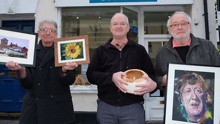 Artists Clive Porter, Rowland Penfold and Mike Dobson with some of their work which will be on displ