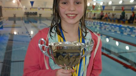 Emilia Dunwoodie picked up the Championship Best Performance cup after breaking three records at the