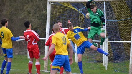 The Buckingham keeper tips a dipping corner over the bar