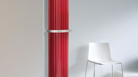 Carre Half-Round radiator, in carmine red, with curved towel rail, from £1,392, available from Vasco