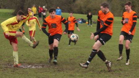 Brookmans Park defenders move in on an Athletico Quat shot