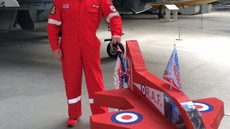 Craig McMurrough, pictured here at Duxford Imperial War Museum, will pull his model RAF Red Arrows H