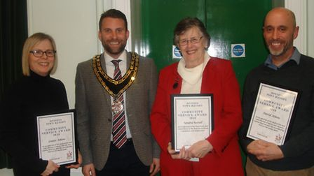 From left to right: Louise Atkins, mayor Ben Lewis, Sandra Restall who won an award for her long sta