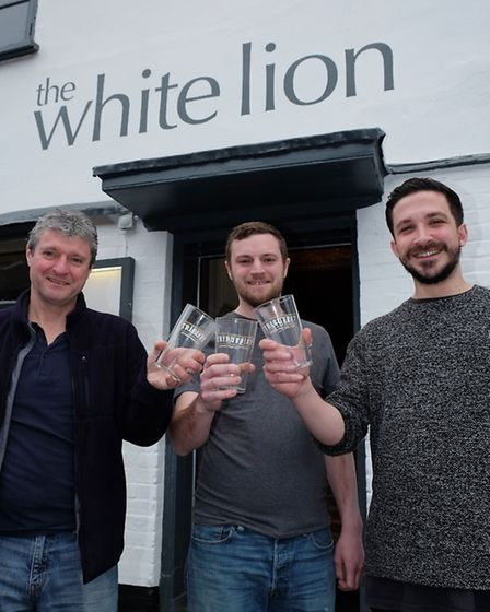 The White Lion landlords Steve McConnell and Andrew Meredith with bar manager James Ward are reopeni