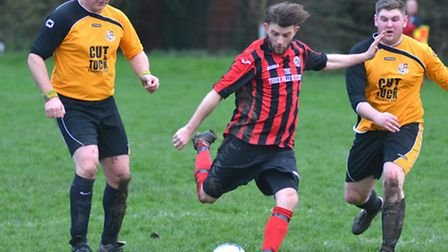 Marc Puckering scores for Houghton & Wyton in their victory against Brampton Reserves last Saturday.
