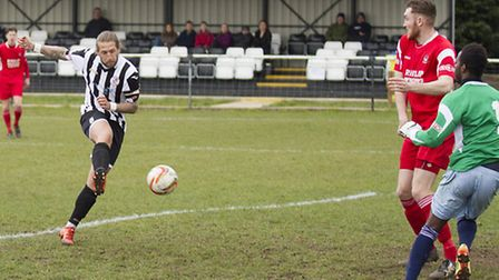 Luke Knight is seen scoring the only goal for St Ives in their victory against Northwood. Picture: L
