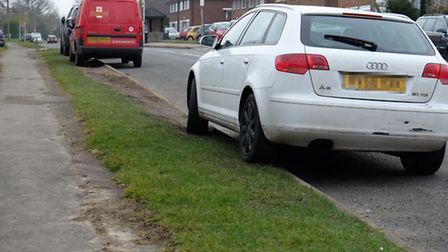 Cars parked on the verge on Wistlea Crescent