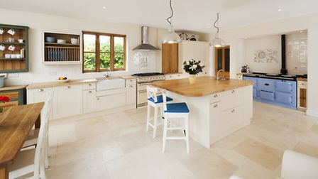 The bright kitchen offers a splash of pastel colour for added country cottage flair