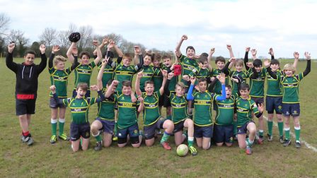Huntingdon Under 13s celebrate their Eastern Counties Plate triumph.