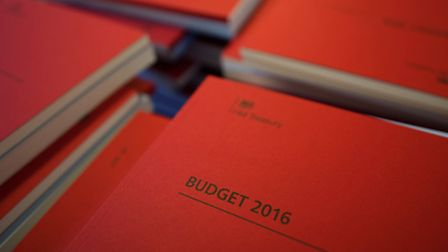 Copies of the Chancellor of the Exchequer George Osborne's 2016 Budget Statement are seen in Westmin