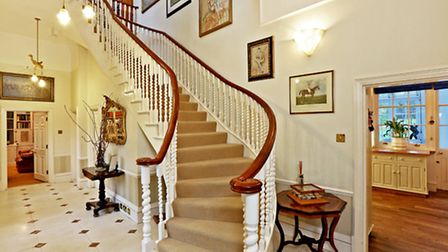 Off the kitchen is the impressive hallway and eye-catching staircase