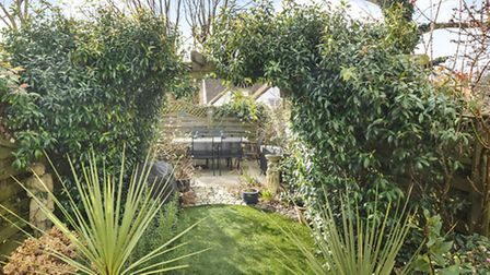 A multi-sectioned garden complete with entertaining area at the bottom
