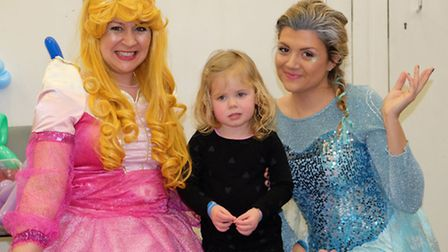 Molly Ward, 2 with characters from frozen at the Refugee Fun Day