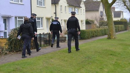 Police preparing to carry out the raid.
