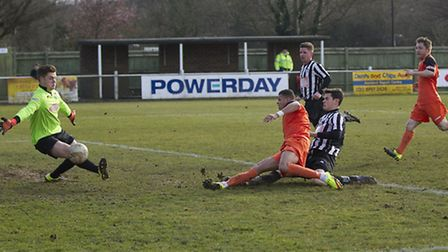 Andrew Phillips slides in to score St Ives Town's winner at Hanwell last Saturday. Picture: LOUISE T