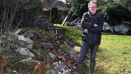 Peter Topping next to fly-tipping in Fowlmere
