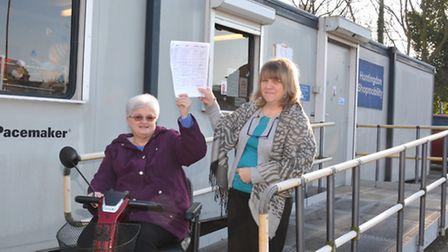 At Huntingdon Shopmobility, are (l-r) Chairman of the Trustees Linda Davies, with Manager Debbie Dre