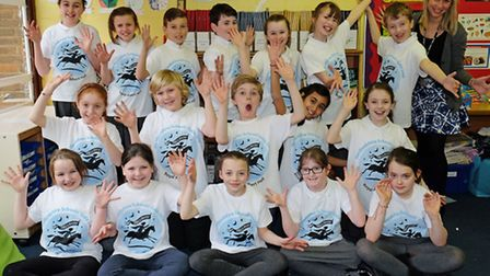 Teacher Shayla Herron with Shenley JMI School pupils who are taking part in a musical extravaganza a