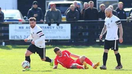 Danny May brings the ball upfield for Royston Town. Picture: David Hatton