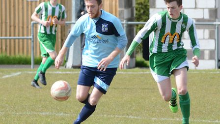 Tom Spark of Godmanchester Rovers in action against Whitton today. Picture: HELEN DRAKE