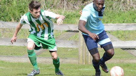 John Yambasu of Godmanchester Rovers turns away from an opponent against Whitton. Picture: HELEN DRA