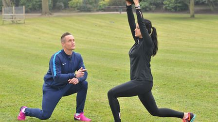 Adrian Woolmer who suffers from crohn's disease coaching a client in his role as a personal trainer
